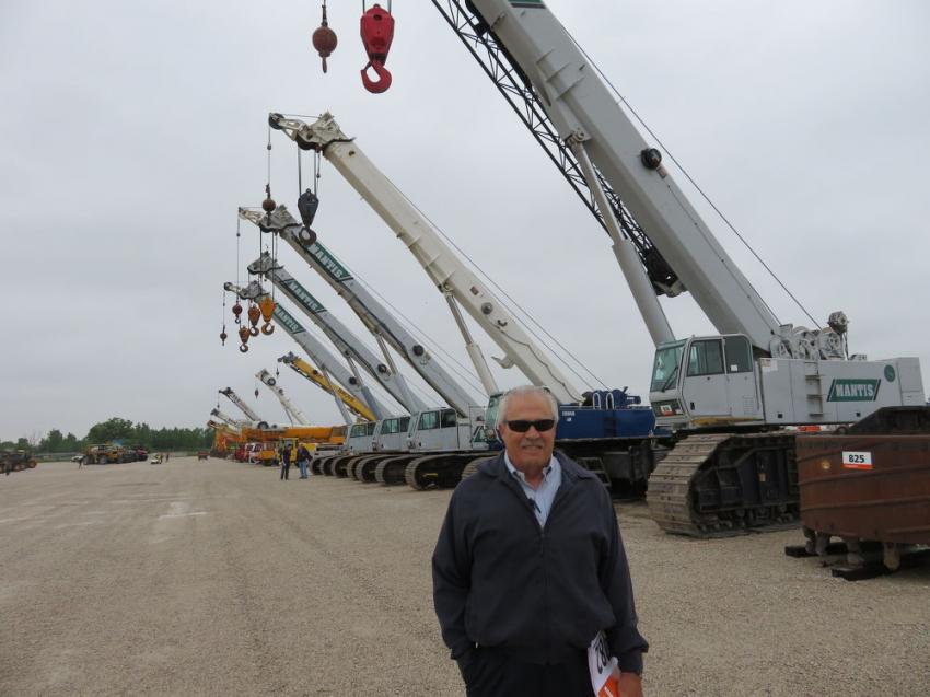 Alan Johnson, area manager of Howell Tractor & Equipment,waits for the bidding to start on the  drill rigs.