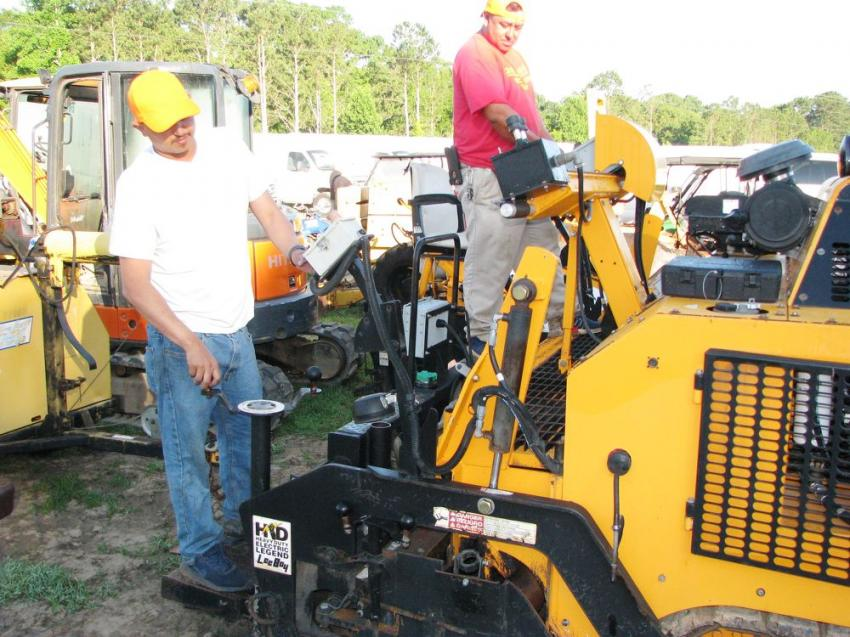 Jorge Martinez (L) and Miguel Burrosero of RGM Paving, East Point, Ga., inspecting a LeeBoy 8616 of interest.