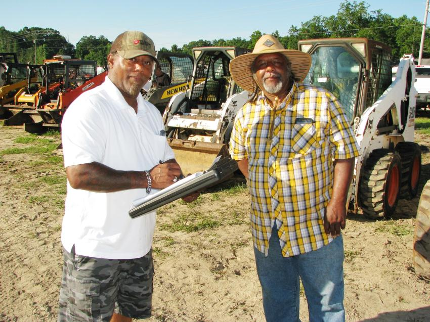 Bernard Gooden (L) and Hollis Goodwin of Lucky Liquidators, Wedowee, Ala., were out looking to buy some compact equipment and maybe a couple of service trucks.
