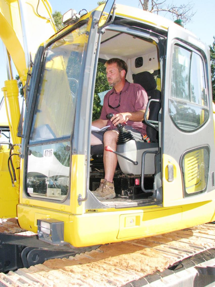 Putting a Komatsu PC138US to the test is Jason Lambert of Lambert Equipment, Sampson, Ala.