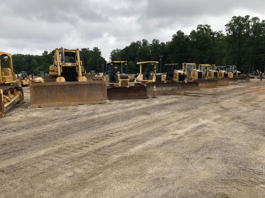 The auction included  Cat, John Deere and Komatsu dozers.