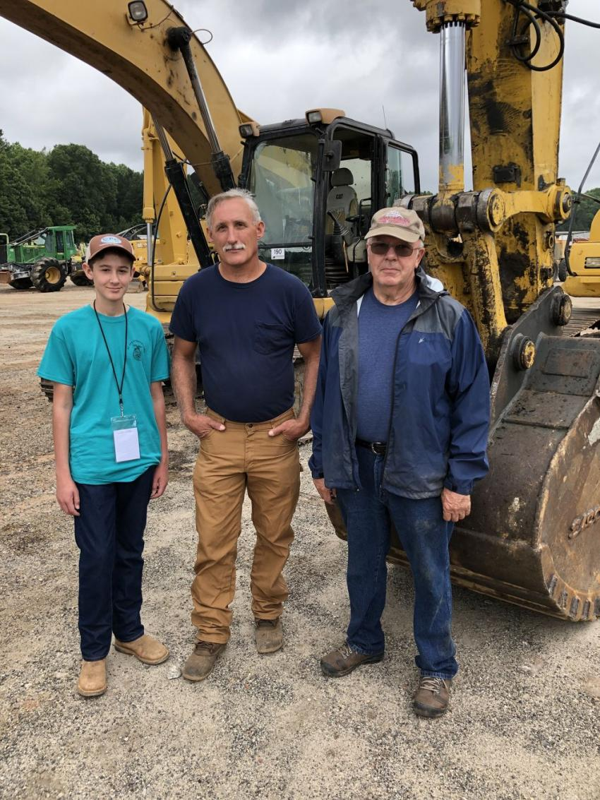Evan and Gary Justus of Gary Justice & Son Grading in Mt. Rest, S.C., and Olin Parton of Parton Excavating, were looking over the excavators.