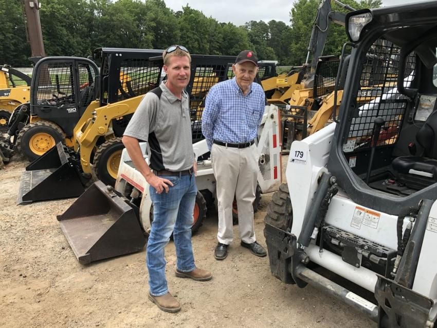 Russ Meadows (L) and James Short of James Short Tractors in Carnesville, Ga., came to see if they could pick a few skid steer loaders.