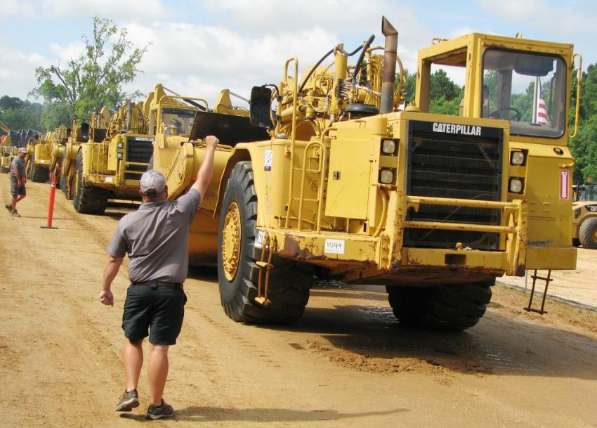 """With another huge selection of Cat scrapers thundering across the ramp at this summer auction, the staff at JM Wood is becoming the """"Kings"""" of scrapers."""