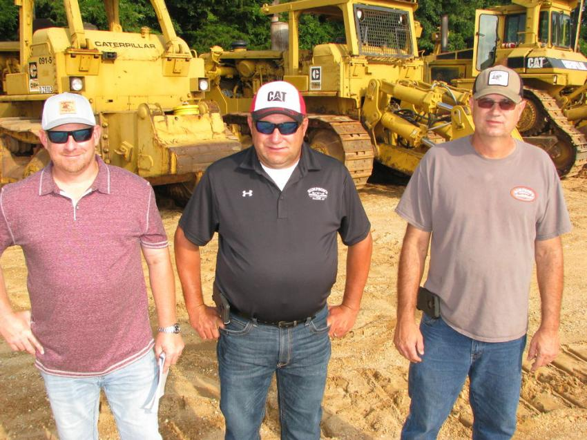 Some boys from North Georgia who always have an interest in the old Cat iron at these sales (L-R) include Shawn Simpson, Greg Simpson and JR Wade of Simpsons Trucking & Grading, Gainesville, Ga.