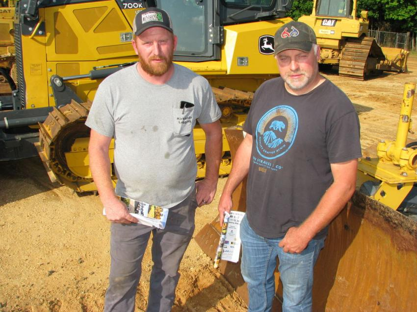 Industry professionals looking over some of the John Deere 700K dozers about to sell to the highest bidder are Jason Kirkland (L) of Kirkland's Logging, Bryson City, N.C., and Mike Shuler of Mike Shuler Excavating, also based in Bryson City, N.C.