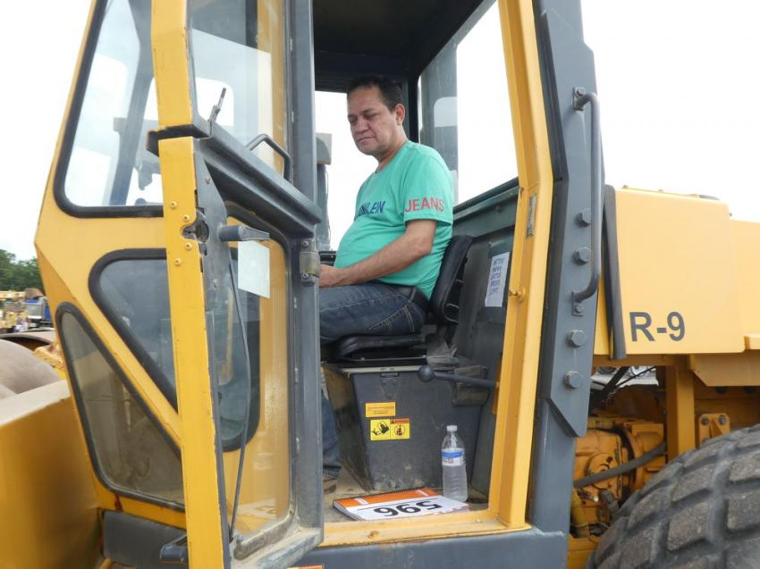 Angel Arteaga from Mexico works the controls on a Dynapac roller.