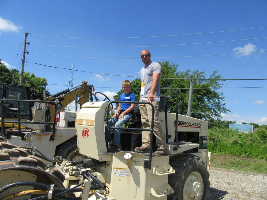 Andy Bolinger of Bolinger Contracting consults his son, Cruz, about a potential bid on this Ingersoll Rand SD-70F compactor.