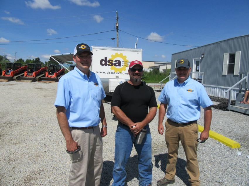 (L-R): Joining Don Smock's Mark Woodward to review the bidding are Crossroads Excavating & Construction's Rodney Cook and Jon Hosier, also of Don Smock Auction Company.