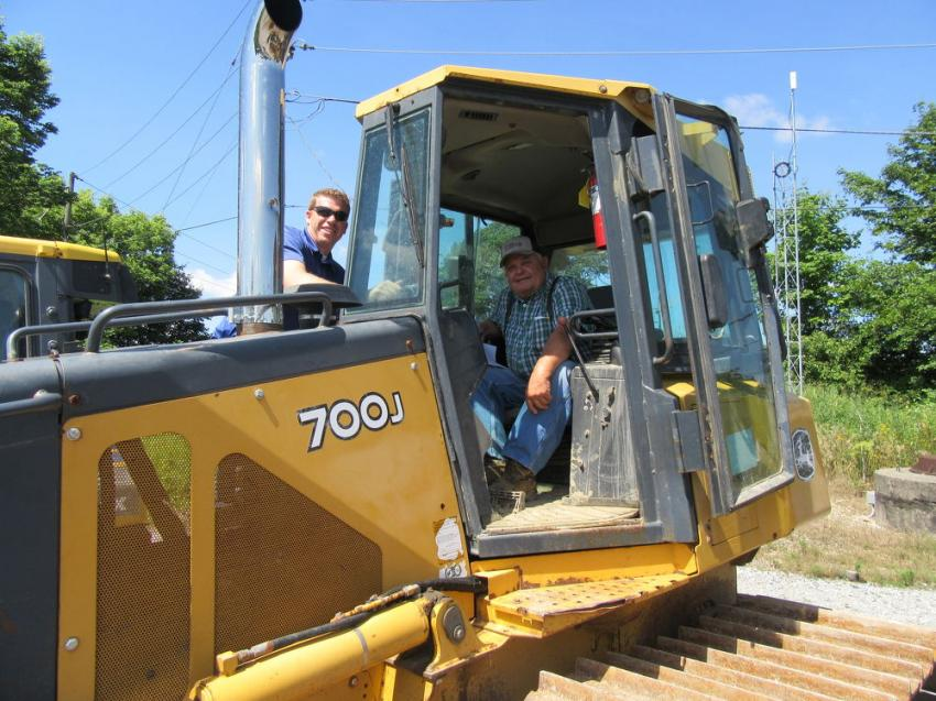 Chris Jackson (L) and Dan Cristiani of Dan Cristiani Excavating Company look over this John Deere 700J dozer.