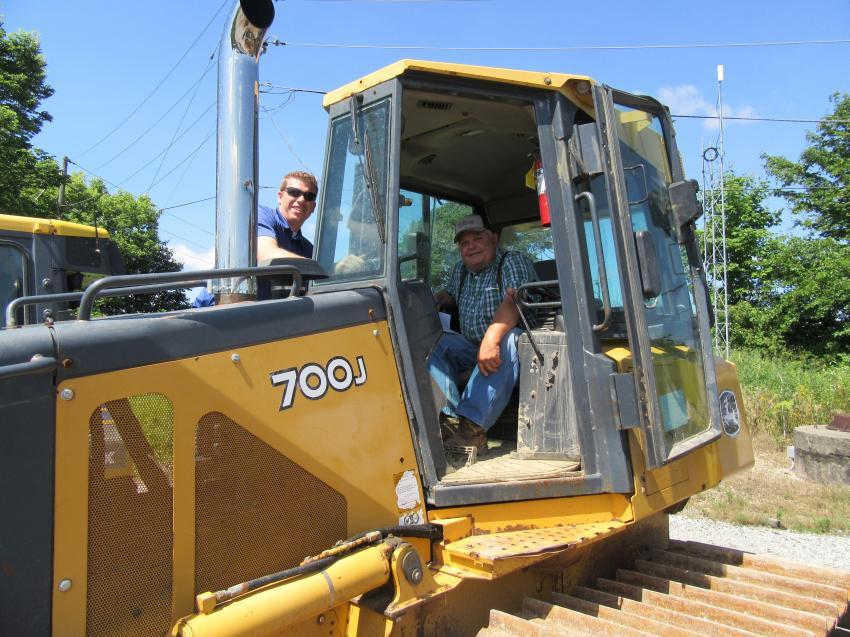 Chris Jackson (L) and Dan Cristiani of Dan Cristiani Excavating Company look over this John Deere 700J dozer.