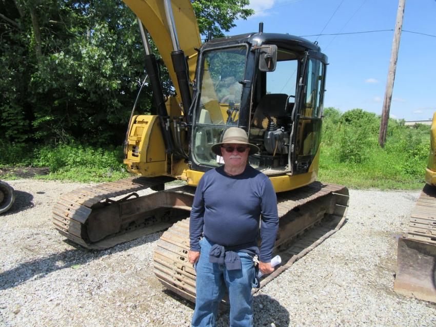 Jerry Watson of Daystar Directional Drilling reviews the excavators up for sale at the auction.