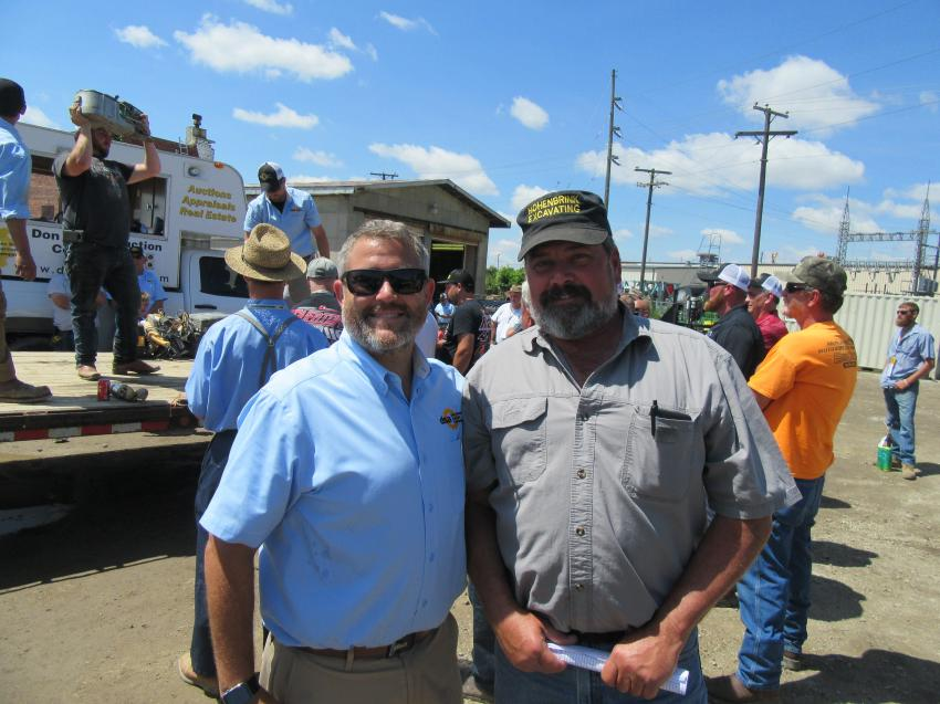 Don Smock Auction Company President Nic Smock (L) catches up with Rick Hohenbrink of Hohenbrink Excavating at the auction.