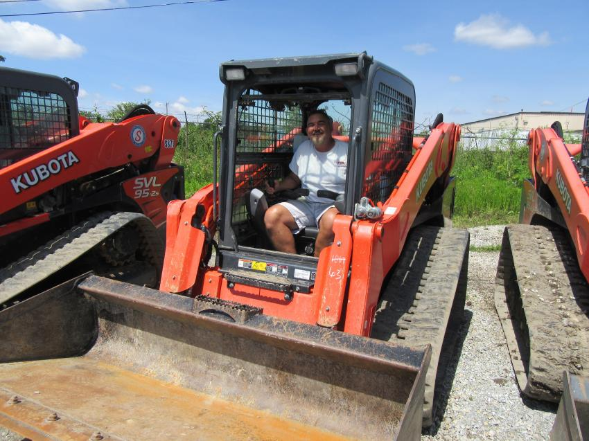 Power Construction's Craig Martin tries out the Kubota SVL 95-2s compact track loader at the auction.