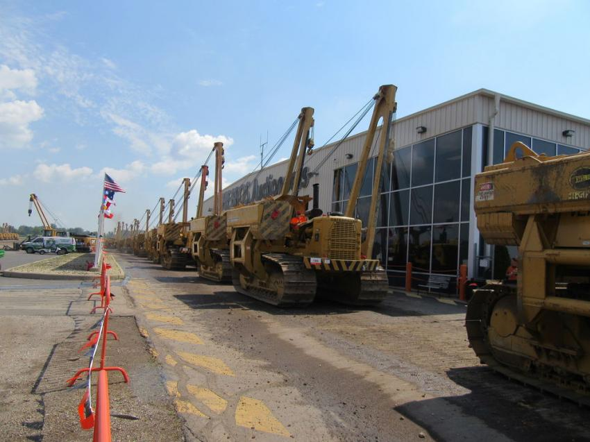 Among the equipment going on the block were 138 pipelayers, which sold in two hours.