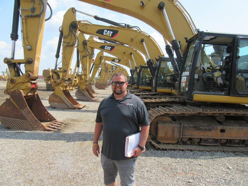 Jeremy Walsh of Leeward Construction, Honesdale, Pa., reviews the extensive lineup of excavators up for bid at the Ritchie Bros. sale in Columbus, Ohio.