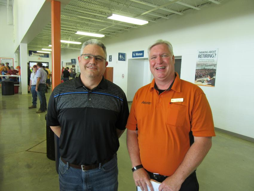 New Holland Territory Business Manager Rich Egleston (L) caught up with Ritchie Bros. Regional Sales Manager Tim Keane at the Columbus auction.