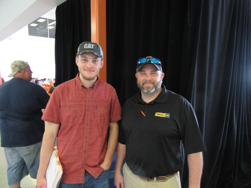 Clay Mahnen and his father, Matt Mahnen of Ohio Cat, enjoy the auction action in Columbus, Ohio.