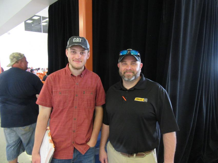Clay Mahnen and his father, Matt Mahnen of Ohio Cat, enjoy the auction action in Columbus, Ohio.