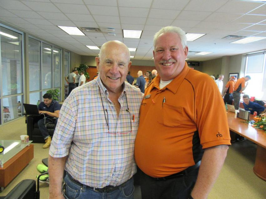 Ritchie Bros. co-founder Dave Ritchie joins Ritchie Bros. Territory Manager Todd Meadows at the auction.