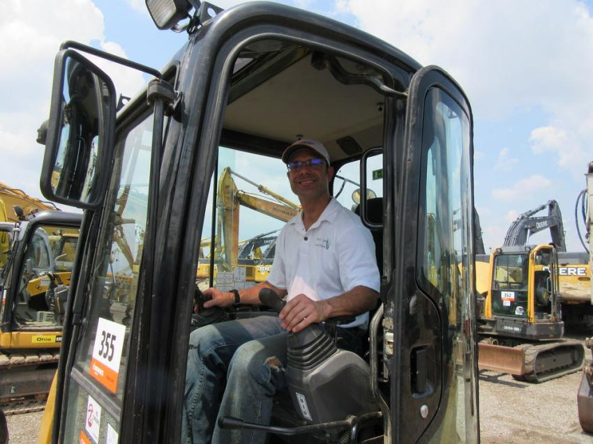 John McDonough of Powell Local Landscaping considers a bid on this Caterpillar 305.5e mini-excavator.