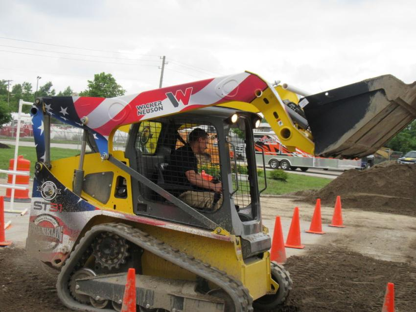 Among the top-10 finalists at the Indianapolis skid steer rodeo, Kiley Wilkes of Heritage Environmental attempts to improve on his placing time.