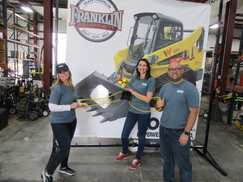 (L-R): Kohler Engine's Angela Kaplan, Dorota Larkin and Joseph Blake welcome attendees to try their hand at a slingshot to win a Kohler t-shirt at the event.