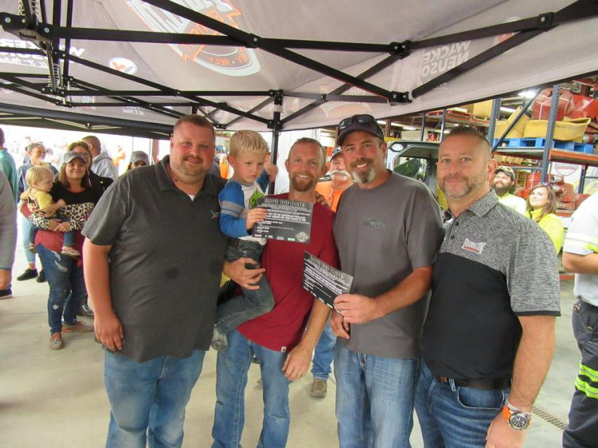 Franklin Equipment Indianapolis Branch Manager Brandon Cutshaw (L) along with Franklin Equipment COO Tony Repeta (R) congratulate first prize winner Richie Wyeth of Wyeth Farms with his son, Weston, and second place winner Brandon Paris of Backhoe Worx LLC at the Indianapolis rodeo.