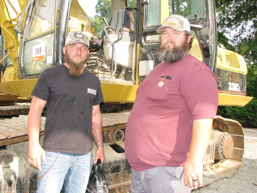 Looking pretty serious about their machine inspections are Daniel Seale (L) of East Metro Equipment & Fleet Service, Conyers, Ga., and Anthony Sinyard of Sinyard Grading, Covington, Ga.