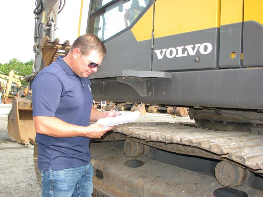 Doug Wilson of Ascendum, based in Charlotte, N.C., inspects a Volvo EC350E hydraulic excavator about to go on the auction block.