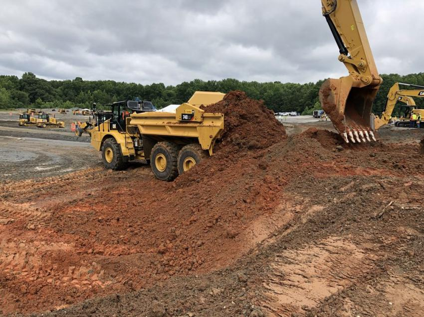 Moving a big pile of dirt is easy with the Cat 740 EJ articulated truck.