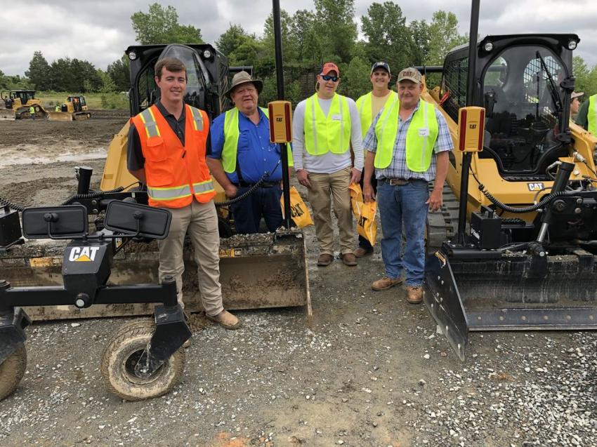 From the left are Seth Burkhalter, Caterpillar; Jeff Bryant, Jeffrey Bryant, Travis Bryant and Dwayne Bryant of Dwayne Bryant Construction in York, S.C.  They are checking out the Cat 299 compact loader featuring Caterpillar's BB121 box blade with Trimble Earthworks Go!