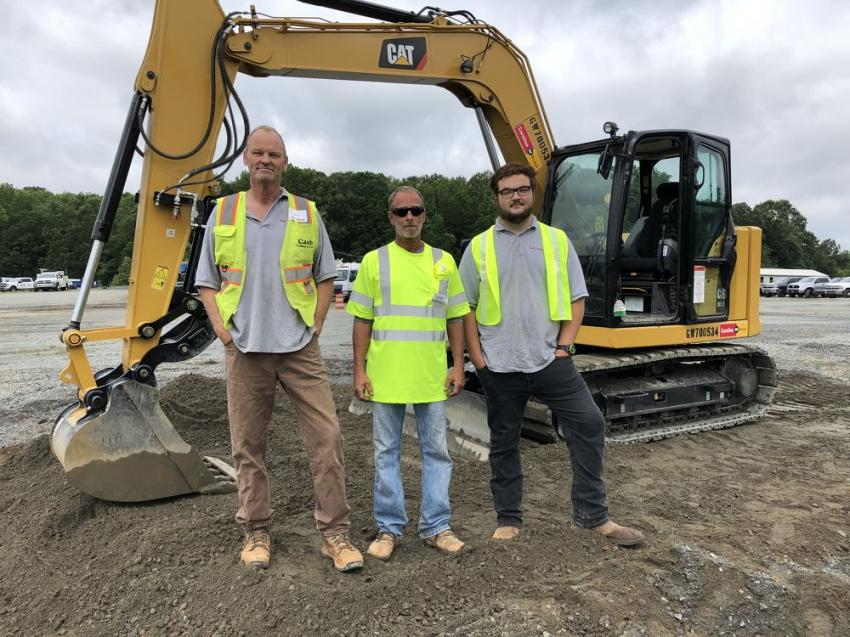 (L-R): Mark Cash, Trevor Murray and Marty Shipman of Cash Grading Co. Inc. in Oakboro, N.C., with the next generation Cat 307.5 excavator with stick steer.