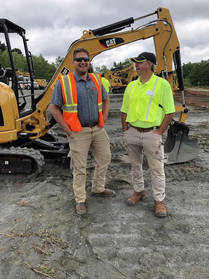 Spencer Sain (L) of Carolina Cat and Phil Arrington of Arrington Grading in Statesville, N.C.  Arrington came to operate the 305.5 excavator; he's a past user and feels the machine is just the right size for his site prep business. He has four other Cat machines.
