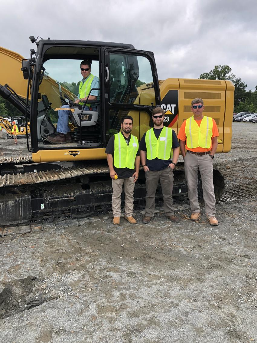 The Next Generation Cat 323 excavator drew the attention of Tom Nash, Fernando Chiriboga and Layne Zirkle of NGE Services in Charlotte.  Also shown is Ethan Mann of Thomas Grading Company in Mathews, N.C.