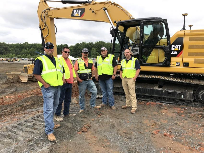 (L-R): Getting ready to test out the factory payload on the Next Generation Cat 330 excavator are Michael Johnson, Martin Murray, Tony LaRocca and Ben Hildebran of Charah Solutions in Louisville, Ky., with Tracy Skipper of Carolina Cat.