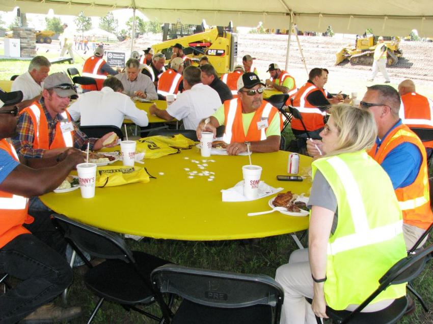 Competitors relax and unwind while enjoying a barbeque lunch with Ring Power and Caterpillar representatives.