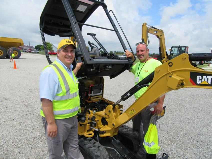 Ohio CAT Technical Training Supervisor Ben Courson (L) reviews aspects of the Caterpillar 301.8 mini-excavator with Chris Piscitello of CP&S Cement Construction. Piscitello was impressed with the machine's accessibility for maintenance.