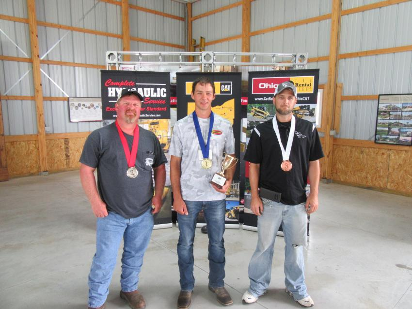 Posing for the winners' shot (L-R) are second-place winner Albert Breech of Breech Septic and Excavating; first-place winner Landon Greer of Courtney Enterprises; and third-place winner Kevin Stewart of Darby Creek Excavating.