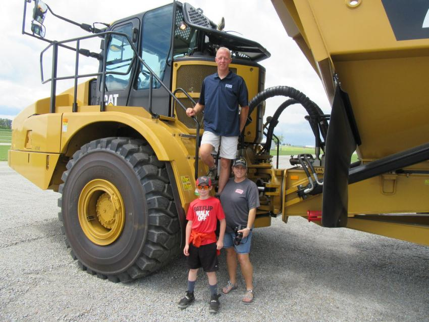 Bud & Malinda Raber of Fryburg Excavating were joined by their nephew, Gabe Troyer, to review this Caterpillar 745 haul truck on display at the event.