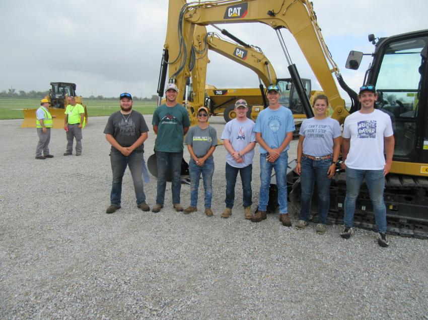 The Farm Science Review Ohio State Student Facility Ground Crew stopped in to take a close look at the Caterpillar equipment.