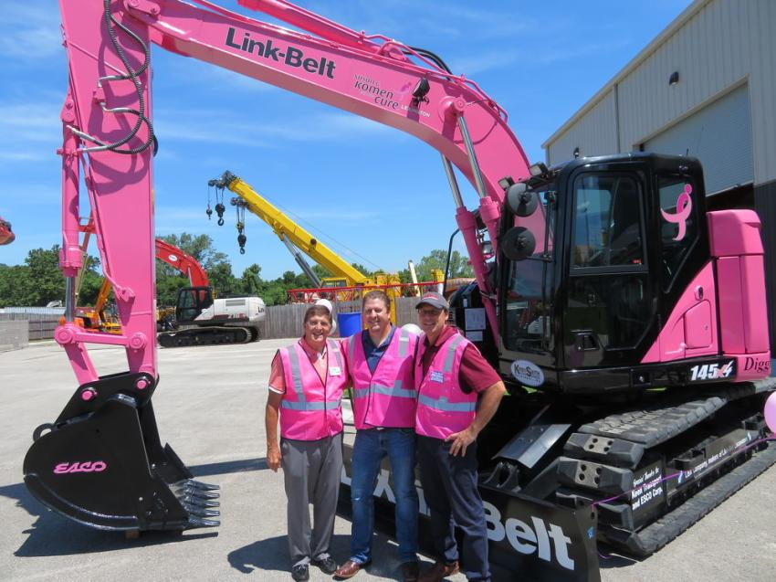(L-R): In front of the Link-Belt 145 X4 pink excavator are Mac Andrew, executive director of NUCA – Greater Kansas City chapter; Bob Snyder, operations manager of Emery Sapp & Sons Inc. and also board of directors, NUCA; and Tony Privitera, executive vice president of Mark One Electric Co and president of NUCA – Greater Kansas City chapter.
