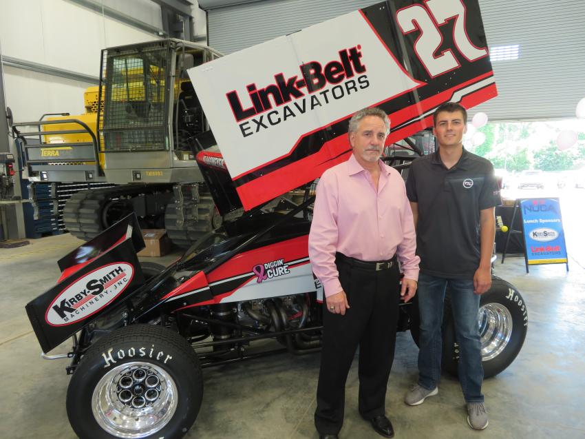 Jeff Weller (L), executive vice president/COO of Kirby-Smith Machinery Inc., and 2018 POWRi National Midget Champion Tucker Klaasmeyer in front of the car that Link-Belt Excavators and Kirby-Smith sponsor.
