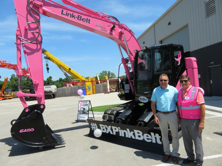 Jeff Stacy of Advanced Drainage Systems, Inc. (L) and Mac Andrew, executive director of NUCA – Greater Kansas City chapter, in front of the Link-Belt pink excavator.