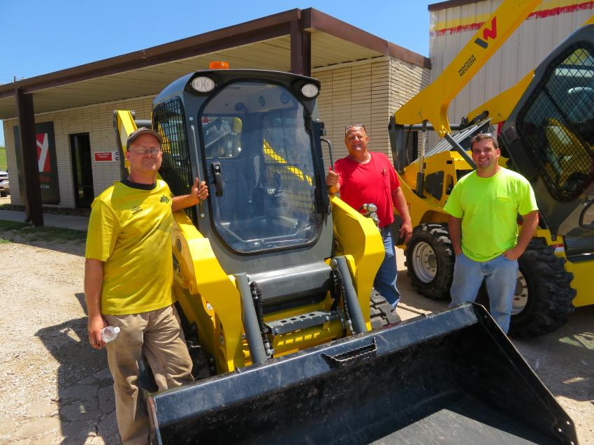 Looking over this Wacker Neuson ST31 tracked skid steer (L-R) are KDOT's David Krieger, Stewart Graves and Derrick Rectenwald.