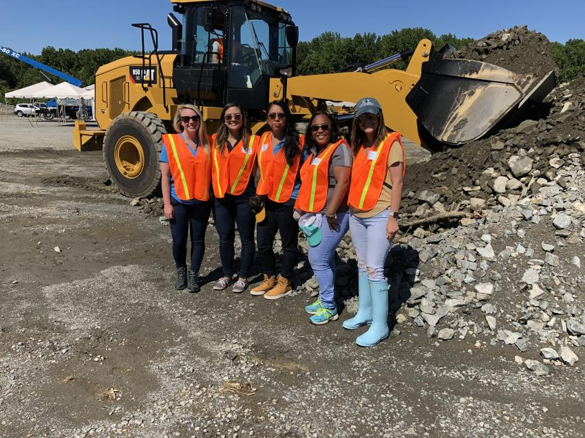 Learning about the Cat 950GC wheel loader (L-R) are Kaitlyn Beck, CTE; Marianne Siercke, Lift One; Myrna Ham, CTE; Tyshima Witherspoon, CTE; and Hannah Kaplan, CTE.