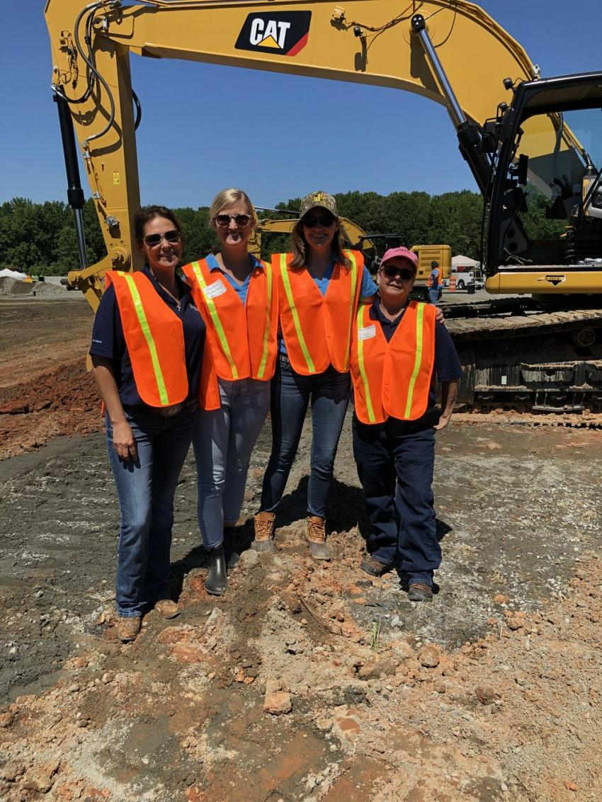 Getting set to try out the Cat 336 Next Generation excavator (L-R) are Jamie Fore, Sitech Mid-Atlantic; Lauren McMillan, CTE; Amanda Weisiger Cornelson, Carolina Cat; and Annie Molkenbuhr, Sitech Mid-Atlantic.