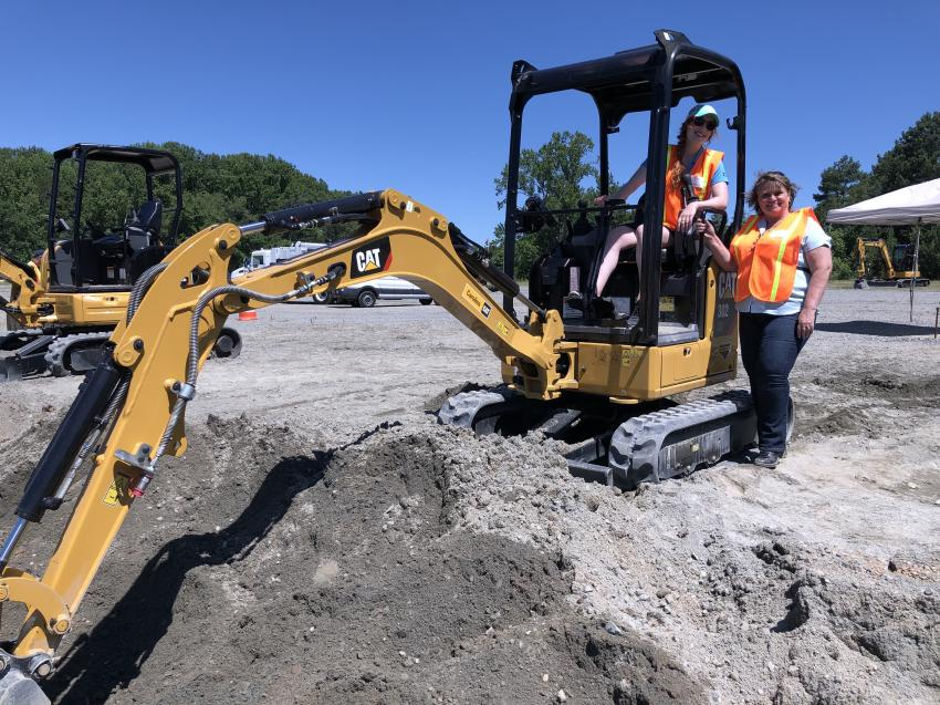 Shown with the Cat 302 CR excavator are Nicole Cortazzo (L) of CTE and Lift One's Lorrie Todd.