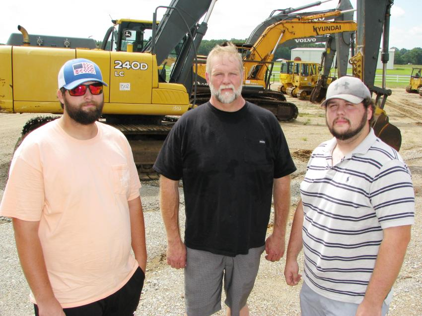 Looking and hoping to grab some bargains on some machines and trucks for their contracting firms (L-R) are Dillon Bridges and Brad Lampton of Pine Belt Construction, Magnolia, Miss., and Joe Alexander of Land Company Development, Magnolia, Miss.