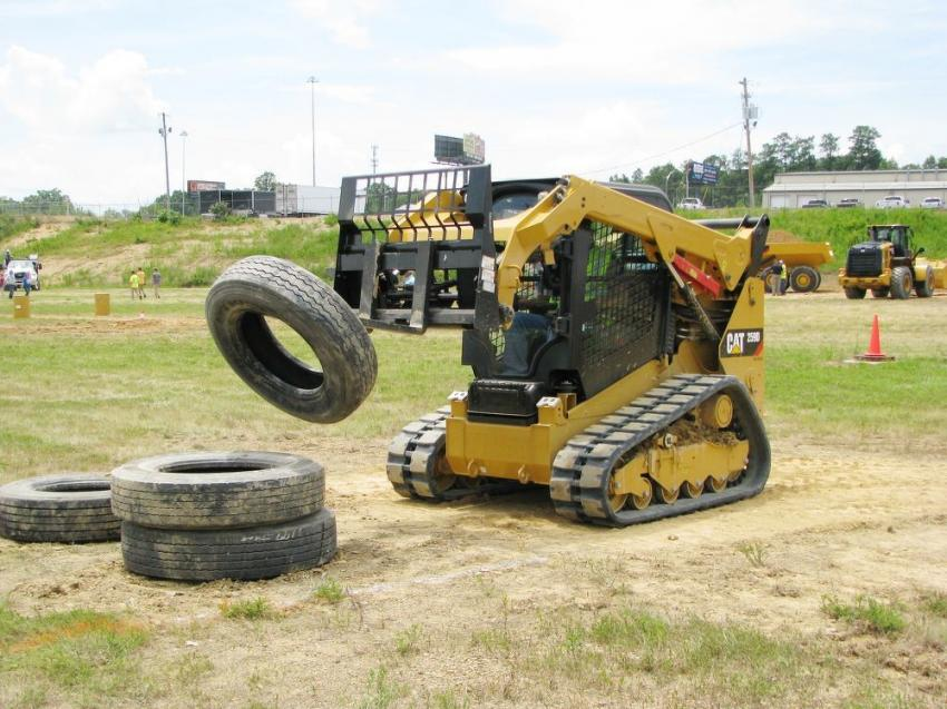 Doing a phenomenal job of stacking tires in the Cat 259D compact track loader challenge is Kelly Childers of Carmeuse Quarry, Saginaw, Ala.